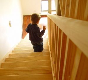 boy walking down stairs