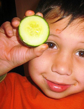 child and cucumber