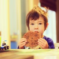 child eating giant cookie