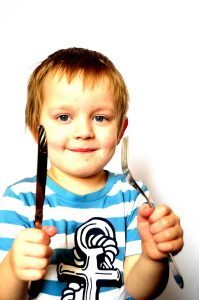 child with knife and fork